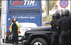 A woman hostage walks away from a hijacked bus as police special forces watch her movement.  Picture / Reuters