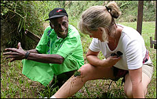 Niumaia Kavika uses his bush skills on the author's injured knee. Picture / Brian Quinn