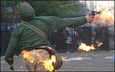 A protester hurls a molotov cocktail at police during clashes in Mar del Plata. PICture / Reuters