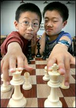 Harry Ruan, 6, and Bobby Cheng, 8, have been picked out by a British chess grandmaster as exceptional players. Picture / Brett Phibbs