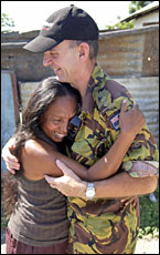 Maria Antonia Gomez, whose neighbourhood was torched by mobs, embraces Colonel John McLeod of the NZ Army.