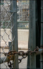 A rusty chained gate keeps most people out of Ground Zero.  Picture / Chris Barton