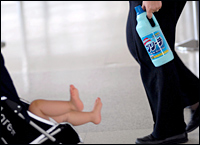 An airline staff member with a bottle of detergent confiscated after Thursday's terror threat. Picture / Reuters