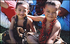 Two boys turn out in their siapo (tapa) lavalavas for the festival.