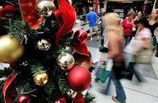 Christmas shopping at St Lukes, Auckland, yesterday. Photo / Chris Skelton