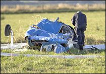 An investigator checks the wreckage of one of the planes involved in the mid-air collision. Marty Melville / Getty Images