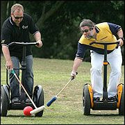 Segway 'Pole Blacks' member Rod Drury (left) steers the ball away from Steve Wozniak. Picture / Brett Phibbs