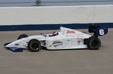 Racing driver Marc Williams, pictured at speed on the high-banked Nashville Superspeedway, is eager for more racing in the United States.
