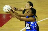 Botlhale Moeng (front) and Sheryl Scanlon (top) in action during the Silver Ferns' match against Botswana. Photo / Martin Sykes