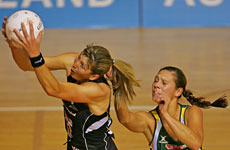 Silver Fern goal shoot Irene van Dyk takes the ball ahead of South Africa's goal keep Adele Niemand. Photo / Brett Phibbs