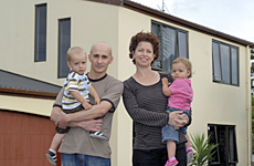 Suze and Stephane Foucher, with their twins Leo and Maya, say their house is leak-free. Photo / Michael Craig