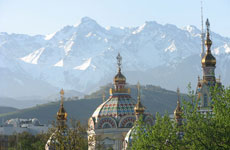 The Tien Shen Mountains behind Almaty in Kazakhstan. In the foreground is a cathedral. Photo / Jill Worrall