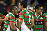 Souths players celebrate their win over the Warriors in Auckland. Photo / Getty Images