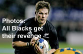 Richie McCaw of the All Blacks is tackled during the win over the Wallabies in Auckland. Photo / Getty Images