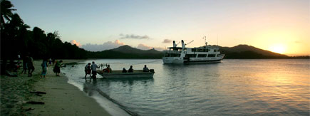 Passengers return to their ship in a longboat after a lovo (Fijian hangi). Photo / Bay of Plenty Times
