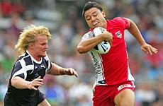 Tonga's Eddie Paea outruns Scot Iain Morrison to score. Photo / Getty Images