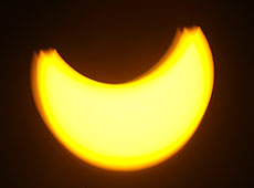 The partial solar eclipse from Auckland city. Photo / Glenn Jeffrey