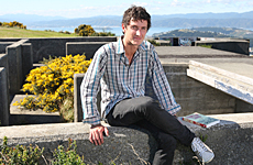 Author Alex Hedley in front of WWII gun emplacements overlooking Wellington. Photo / Mark Mitchell