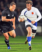 France fullback Maxime Medard heads away from Luke McAlister on the way to scoring his memorable try. Photo / Getty Images