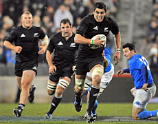 Issac Ross of the All Blacks takes the ball up with support from Owen Franks and George Whitelock. Photo / Getty Images
