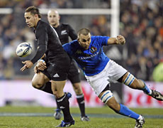 All Black first-five Luke McAlister loses the ball in a tackle during last night&#39;s test against Italy. Photo / Getty Images