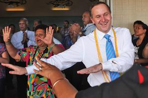 John Key gets into the swing of things at the Matavai Resort on Niue. Photo / Getty Images