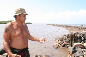 Mervyn Dudoit plans to give away the harvested fish to the community. Photo/ Jim Eagles