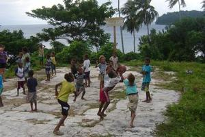Children on the island of Pentecost play basketball court at the Latano Catholic Mission. Photo / Catherine Masters