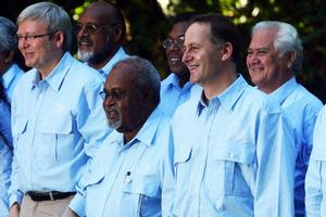 Kevin Rudd (far L) gave Pacific leaders the option of a blue or beige shirt but they were all in agreement on the colour. Photo / Getty Images