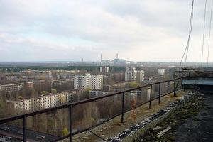 A view across the apartment blocks of Pripyat to Chernobyl in the distance. Photo / Wikimedia Commons image