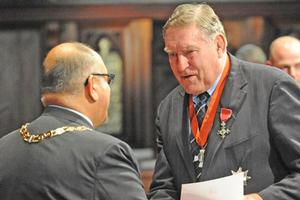 Rugby legend Colin Meads receives his knighthood from Governor-General Sir Anand Satyanand. Photo / NZPA