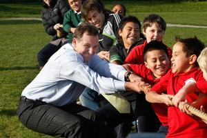 John Key launched Kiwisport on Tuesday at Bairds Mainfreight Primary School in Otara, but many low-decile schools in the area face cuts of about 25 per cent. Photo / Brett Phibbs