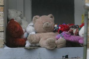 Toys outside the Rotorua house where Trent Matthews died. Photo / Alan Gibson
