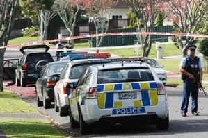 Armed police guard the scene in Leith Court in Papatoetoe after an Asian male was found stabbed in a car this morning. Photo / Greg Bowker