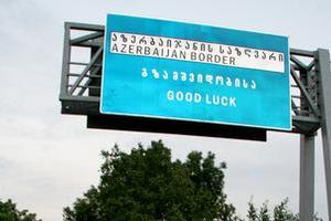 A multi-language sign welcomes motorists crossing the border into Azerbaijan. Photo / Matt Kennedy-Good