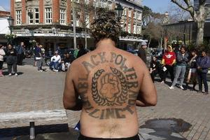 Black Power gang member Eugene Ryder displays his patch tattoo during the anti-gang patch by-law protest at Majestic Square, Wanganui. Photo / Mark Mitchell