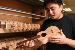 Brian Benavente at the Ko Aloha ukulele factory in Honolulu, Hawaii. Photo / Jim Eagles