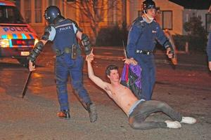 One of the 67 people arrested in the Undie 500 riots is dragged away from Castle St. Photo / Otago Daily Times