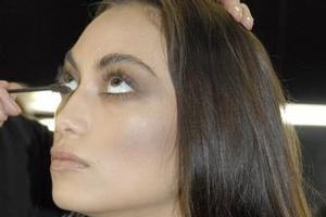 A model has her makeup applied backstage at Andrea Moore. Photo / Nicole Saunders