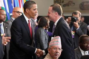 Barack Obama approaches John Key at a UN lunch (above). NZ later joined the US in a walk out during Mahmoud Ahmadinejad's UN address. Photo / NZPA