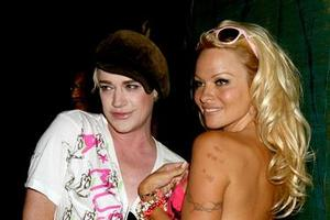 Pamela Anderson and Richie Rich in Auckland last night. Photo / Getty Images
