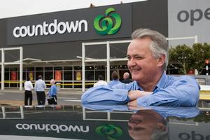 Peter Smith unveiled the new Countdown colour scheme and logo at Westgate Mall yesterday. Photo / Paul Estcourt