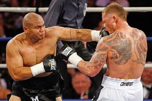 A leaner, meaner David Tua made short work of Shane Cameron. Photo / Getty Images