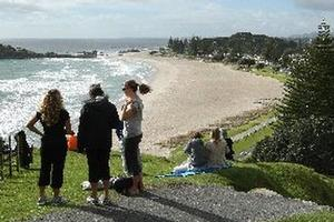 People gather on the high ground of Mt Maunganui to watch for a possible tsunami. Photo / Alan Gibson