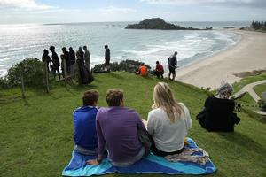 The Mount attracted its share of people keen to glimpse a tidal wave. Photo / Alan Gibson