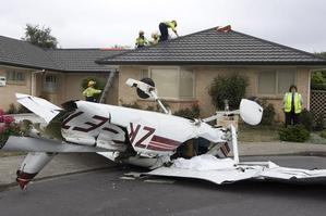 The Cessna plunged into a residential street after the collision. Photo / Mark Mitchell