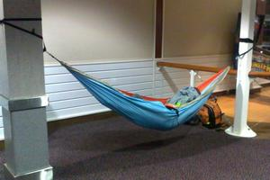 This traveller took his comfort seriously, stringing up a hammock between two pillars for his airport slumber.  Photo / Supplied