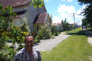 Perry Dotaona, chairman of the Samarai Tourism Authority, in the island's main street. Photo / Jim Eagles
