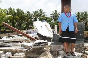 David Tua, whose aunt died in last week's tragedy, stands in the rubble of the Sinalei Resort. Photo / Greg Bowker