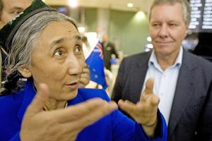 Rebiya Kadeer was greeted at Auckland Airport yesterday by her host, Green MP Keith Locke (rear). Photo / Richard Robinson